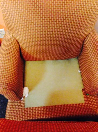 Budgetel Savannah: Under the chair cushion in the room