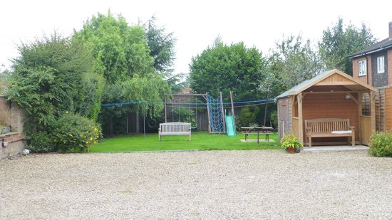 Apple House Guest Accommodation: Back of House  play area for children.