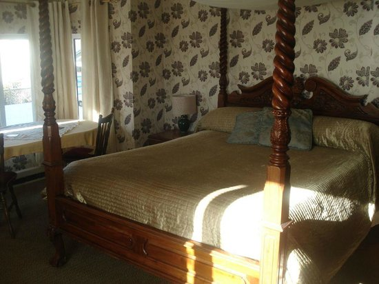 Lyme Bay House: Four Poster Bed Room - bright sunny day - cool inside