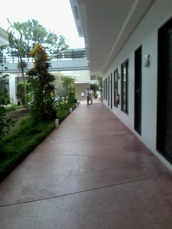 The Oriental Hotel Leyte: hallway from rooms to the pool area and resto