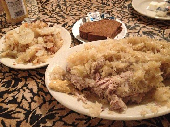 Schnitzelbank Restaurant : Pork ribs, saurkraut, German fried potatoes and pumpernickel bread - comfort food to this old Ge