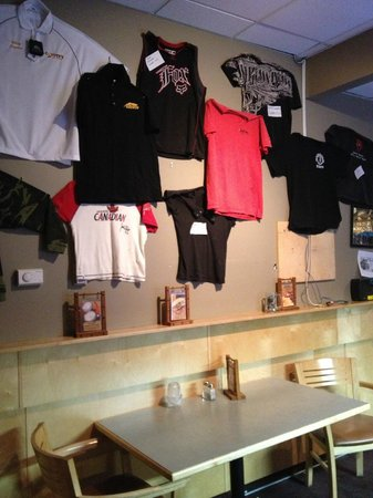 """Coyote's Steakhouse and Lounge: Shirt """"wall of shame""""  - Shirts lost to Ed in pool."""