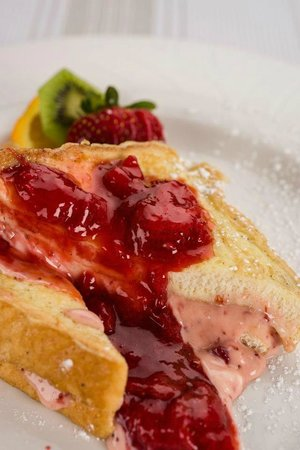 Coyote's Steakhouse and Lounge: Our Strawberry Cheesecake Stuffed French Toast - Available Saturdays!