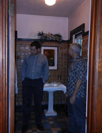 Rutherglen Mansion: My handsome husband and son admire the bathroom tile.