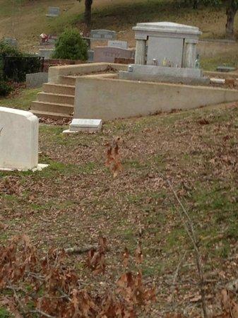 Rowan Oak: People leave bottles of bourbon on Faulkner's gravestone.