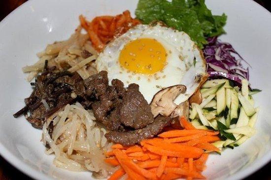 Hashigo Korean Kitchen: Bibimpap. Mixed vegetables with bulgogi (marinated sliced ribeye) with a sunny side egg on top.