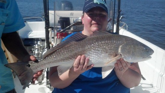 Reel Action Fishing Charters: My wife and her catch.