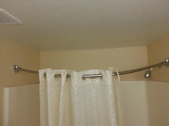 Comfort Inn Indianapolis-Carmel: This is as far as the shower curtain would stay closed. The shower rod was mounted bent downward