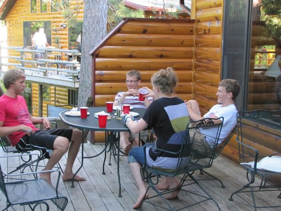 Breezy Point Resort: Enjoying the deck on the back of our cabin.