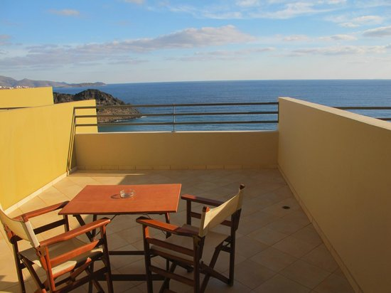 Blue Marine Resort & Spa: Balcony with table and chairs overlooking the Aegean