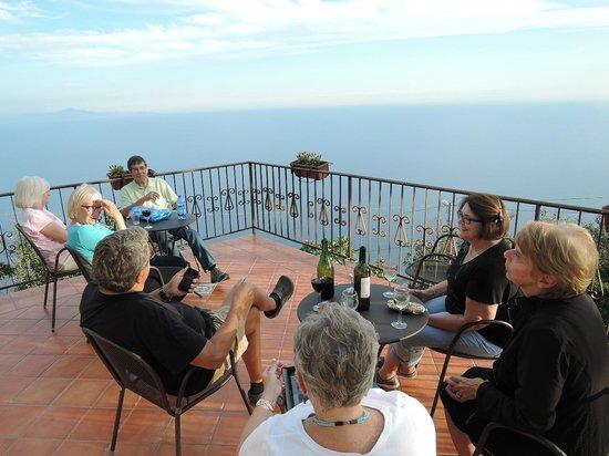 Nido Degli Dei: Relaxing on the patio overlooking the Mediterranean.