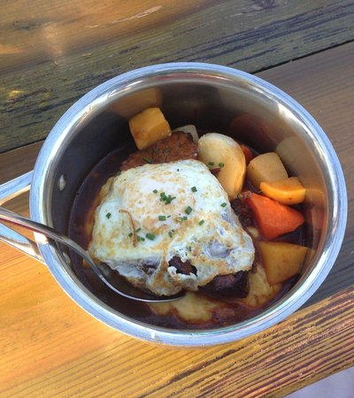 Salty Sow: Slow cooked pork with fried egg. Served in the pot.