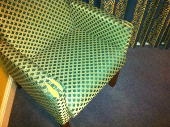 Great National Abbey Court Hotel & Spa : ripped armchair bedroom