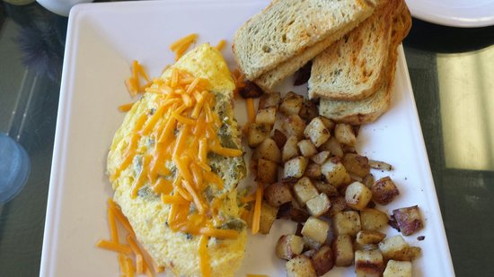 Cornerstone Bakery & Cafe Co: Green Chile and Ham Omelet with Red Potatoes and Green Chile Toast...Mmmmmm
