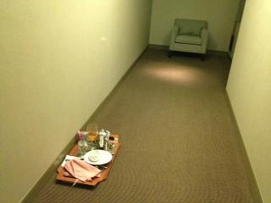 The Westin Baltimore Washington Airport - BWI: Dirty room service trays left in hallway (notice the odd chair)