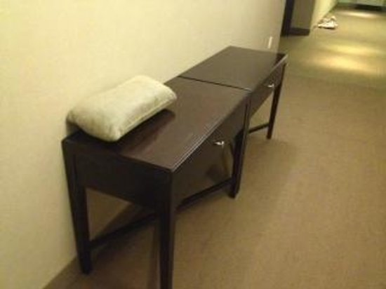 The Westin Baltimore Washington Airport - BWI: Two tables and a pillow tossed on top in hallway.  7th floor