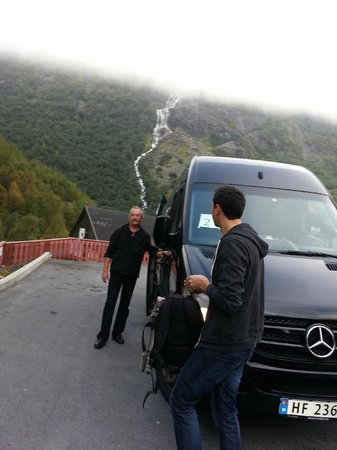Briksdal Glacier (Briksdalbreen): Our glacier express shuttle van and driver with waterfall in background