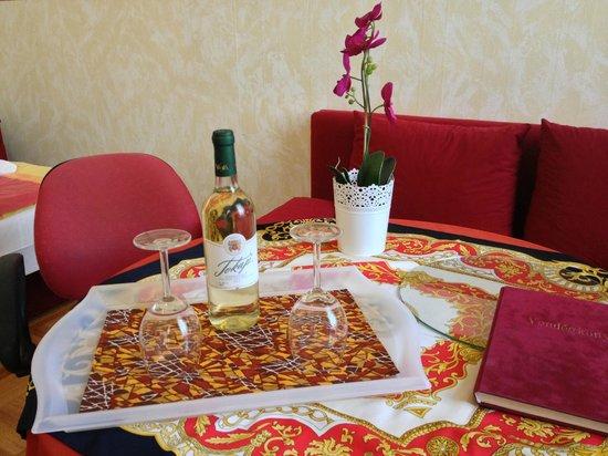 Firstapartments Inn City Center: Complimentary wine + table
