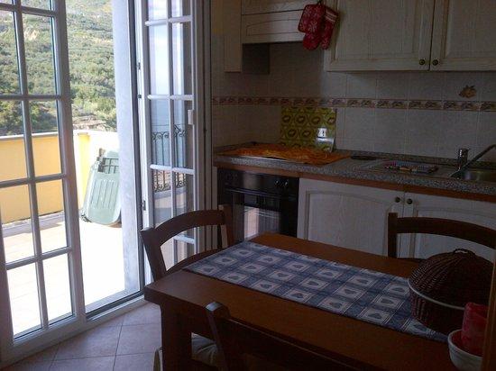 La cuisine avec porte menant sur la terasse. - Picture of Bed and ...