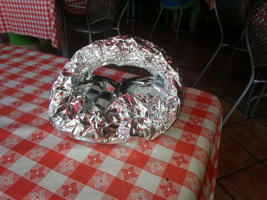 """Tomato Charlie's : the """"to go"""" container.  the pizza is all stuck together, and looks more like a paninni afterward"""