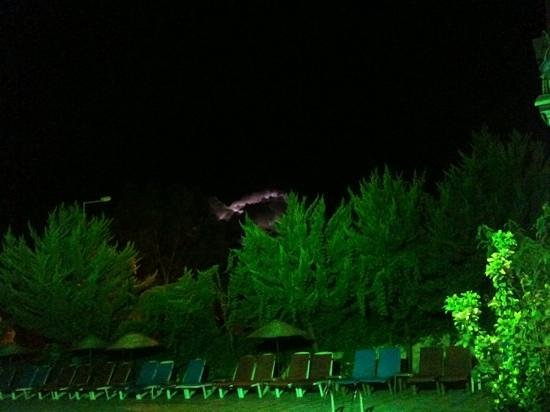 Emre Apartments: night Pool round