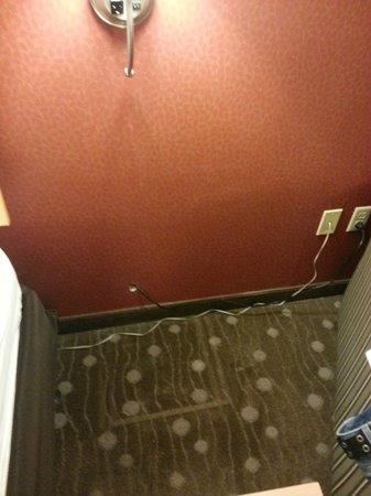 Comfort Suites: Instead of wiring in a lamp, they cut a hole in the wall and ran it over to the outlet.