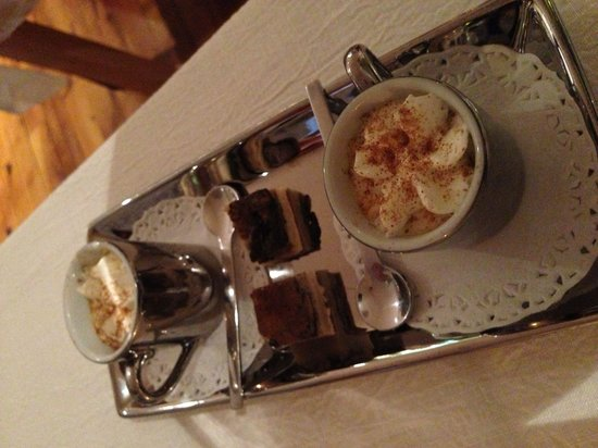 O de Mer : Amuse Bouche for two. A creamy fish soup with coco powered and truffle shavings served in a tiny