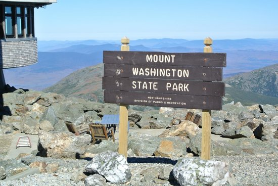 Mount Washington Auto Road: Sign at the Summit.  Line for photo's.