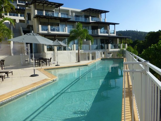 Whitsunday Reflections: Lap pool at the complex with loungers to lay on
