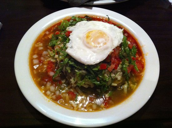 """Maize Cantina: Chicken enchilada with """" Christmas""""sauces, both red and green chiles."""