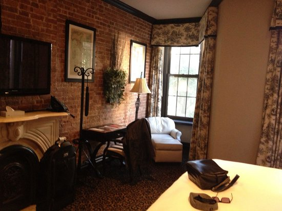 The French Quarters Guest Apartments : Room 207.  Sitting area/desk area.