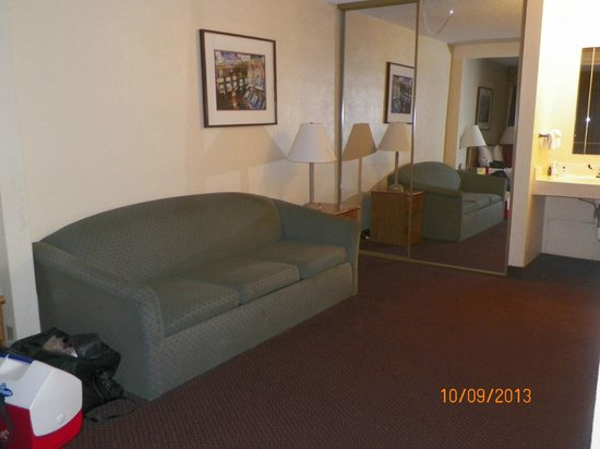 Mardi Gras Hotel & Casino: From the bed area, showing the couch, looking toward the back of the room