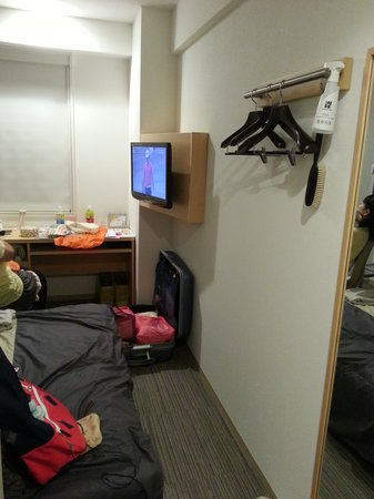 Super Hotel Asakusa: Flat screen TV with limited channels & desk with cable socket & a large foldeable vanity mirror