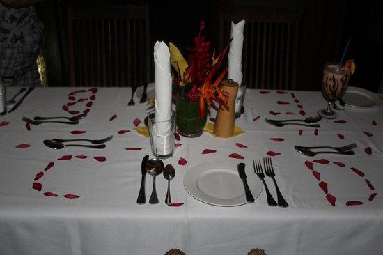 Savasi Island Villas: Table setting with Initials in Petals