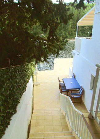 Korcula Waterfront Accommodation: View of private waterfront terrace from the stairs