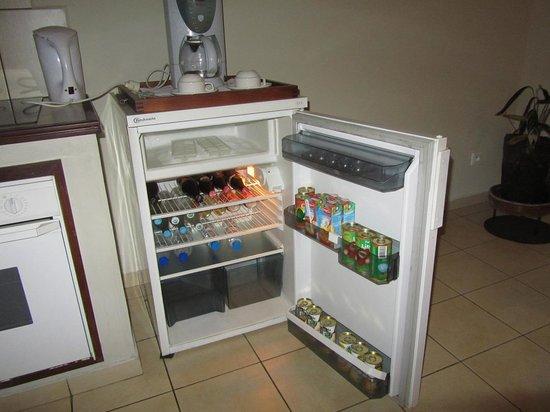 La Residence du Rova : The well stock room fridge.  Pleny of beer