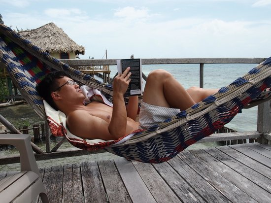 Thatch Caye Resort : reading on our front deck hammack