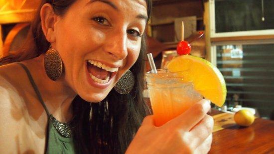 Thatch Caye Resort : wife enjoying a fabulous rum punch
