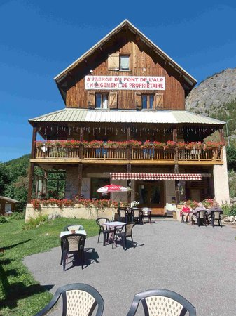 Auberge Du Pont De L'alp : The Auberge from the outdoor dining area