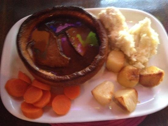 sunday dinner at the casbah. beautiful! giant Yorkshire pudding, beef, carrots, mashes potato, r