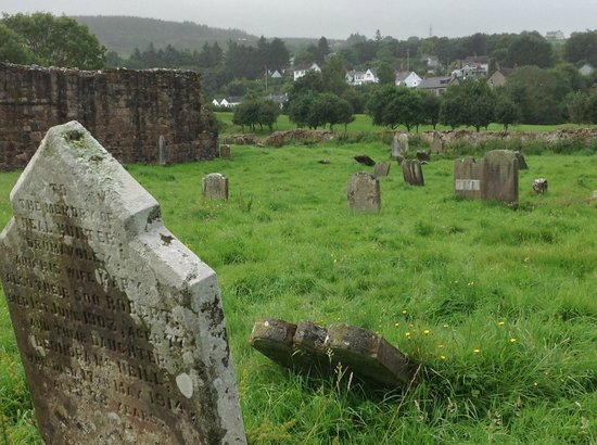 Bonamargie Friary : Friary Graveyard, Ballycastle beyond the trees