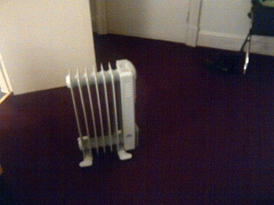 The Crown Hotel: The heating.  Only 5c outside. With Listed draughty sash windows.