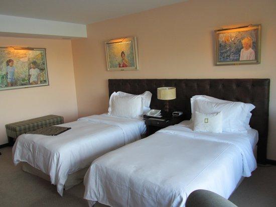 Guest room with art at El Casco Art Hotel