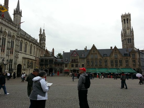 Bruges Town Hall on left and Church of the Holy Blood in the corner