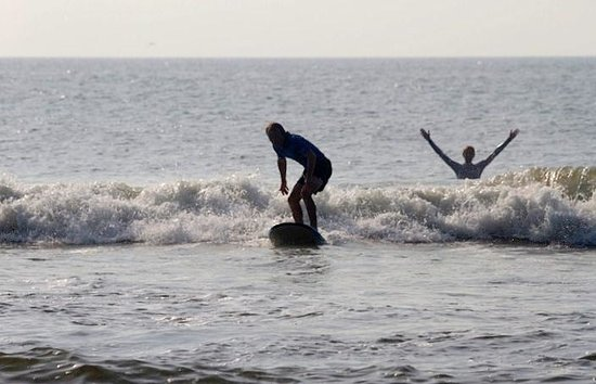 Tony Silvagni Surf School: me getting up on a board-the instuctor's hands are raised :)