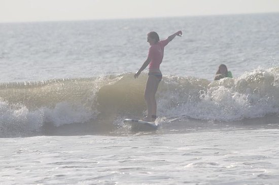Tony Silvagni Surf School: my daughter on her first ride :)