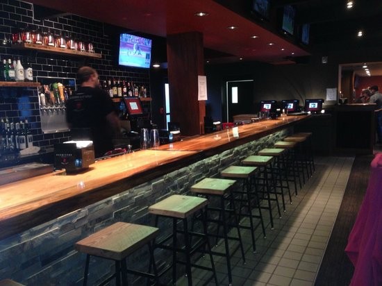 Mac's Bar and Grill : Well-lit and stocked bar.