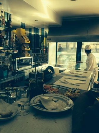 Os Jeronimos: at the counter with the grill cook at front window