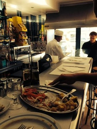 Os Jeronimos: carlos the manager visiting with the grill cook