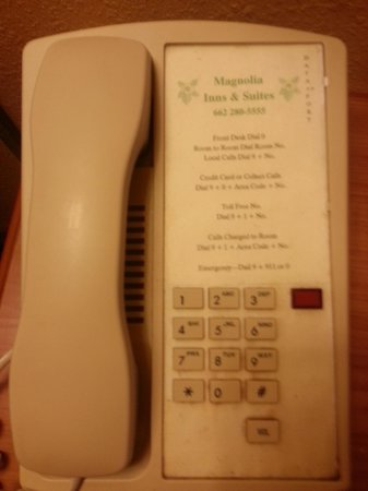 Magnolia Inn and Suites: Phone in room